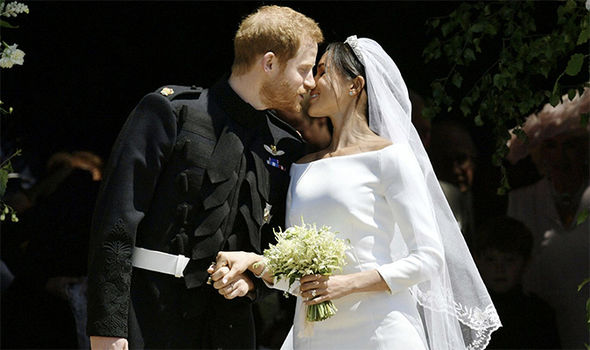 Harry, Meghan Kiss as Married Couple (Watch)