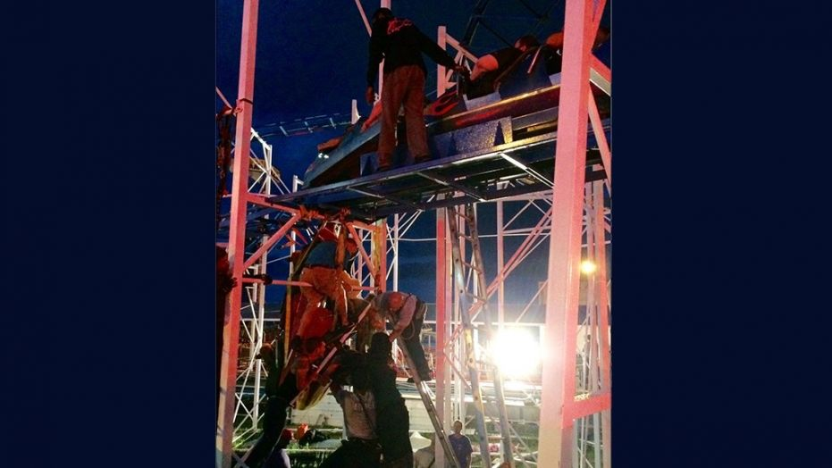 Roller coaster riders thrown, 2 people fall