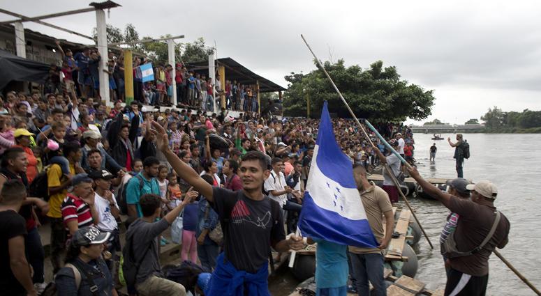 Caravan breaks fence, down gate at Mexico crossing