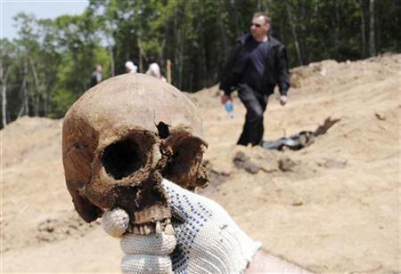 Stalin-era mass graves yields tons of bones, Report
