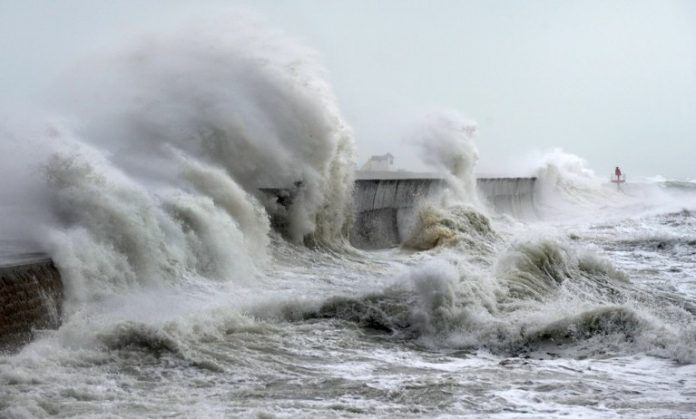 Ocean warming: strong waves wash historic lighthouse beacon into Lake Michigan