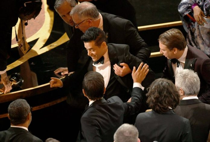 Rami Malek Falls Off Stage After Oscar Win (Picture)