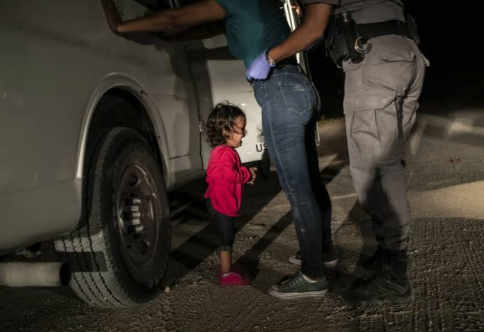 John Moore: 'Crying girl' picture near border wins World Press Photo