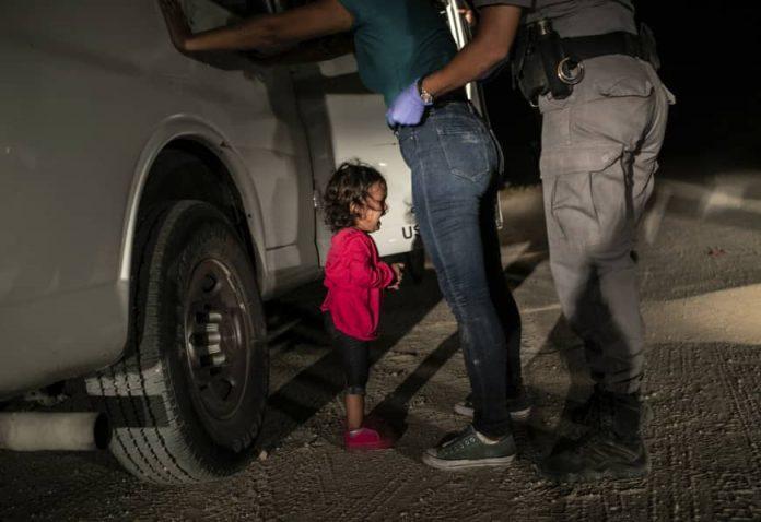 John Moore: 'Crying girl' picture near border wins World Press Photo
