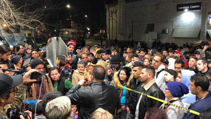 Border bridge shut down after dozens of migrants waiting