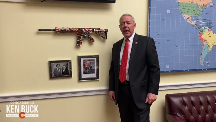 Ken Buck wields AR-15 in office (Watch)