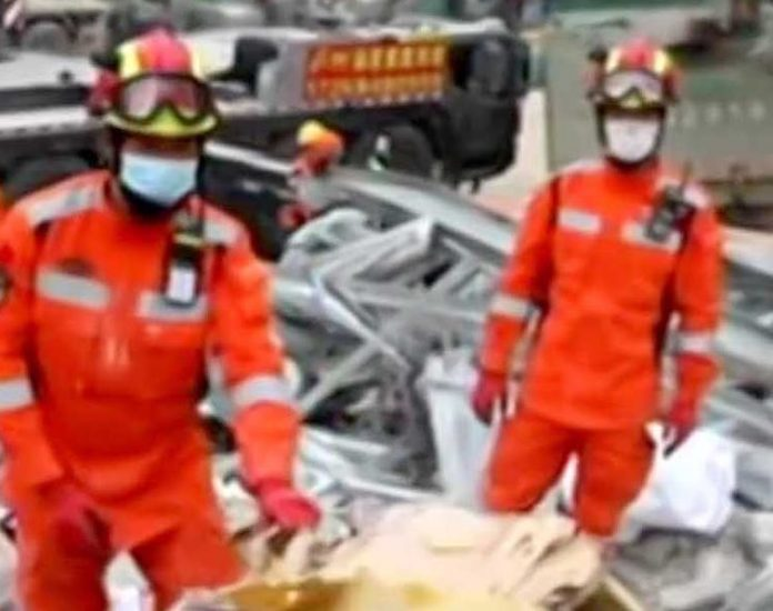 Mother, son rescued in China from rubble after 52 hours