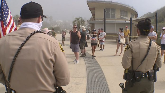Coronavirus USA Updates: 3 people arrested during 'Freedom Rally' protest at San Diego beach