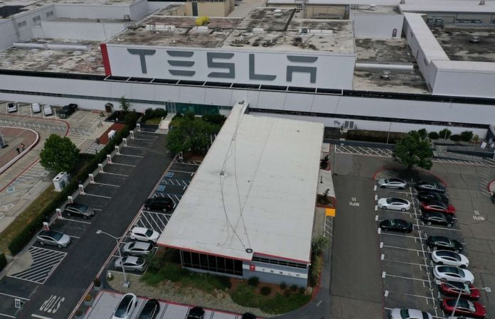 Coronavirus USA Updates California authorities says Tesla can reopen factory with new safety measures