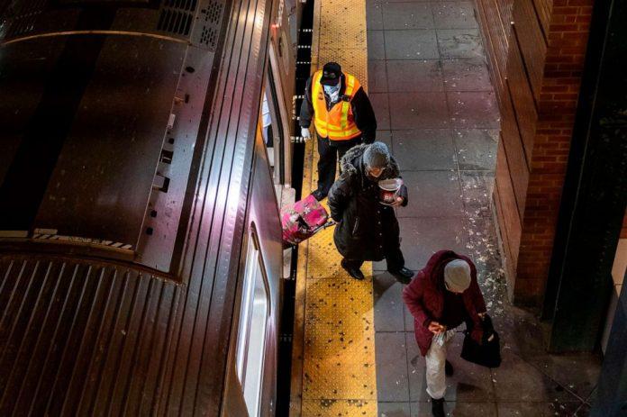 Coronavirus USA Updates: NYPD clears people from subway during start of overnight shutdown