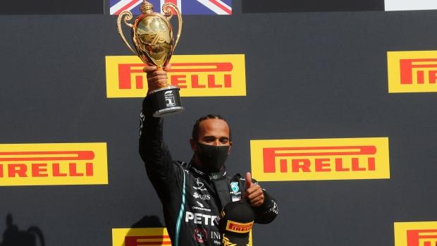 Lewis Hamilton holds on to win wild British GP
