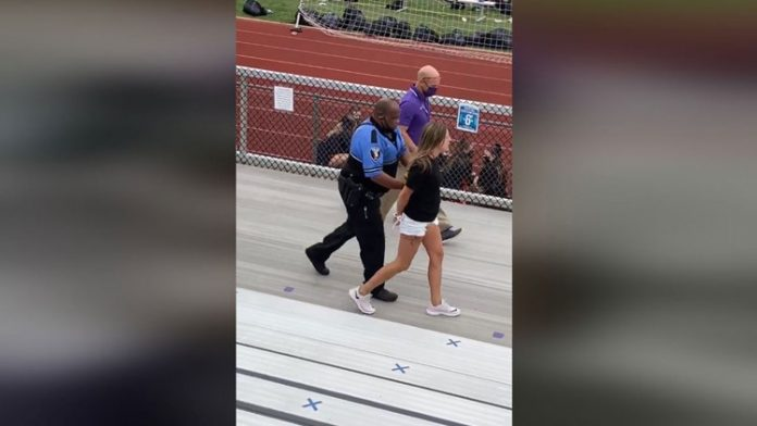 Police tase woman at football game in Logan, Ohio (Video)