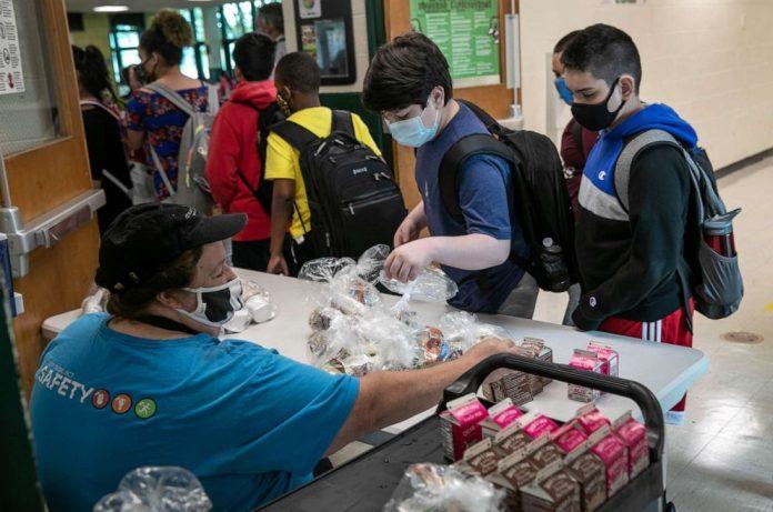 Coronavirus USA Updates: Free school meals extended through end of school year
