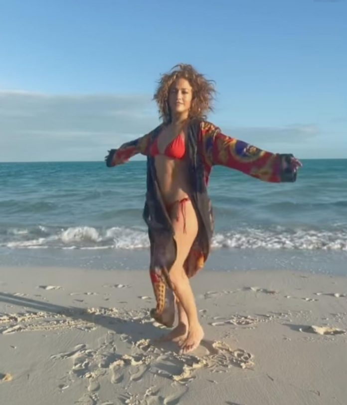 Watch: Jennifer Lopez WOWS in red bikini as she performs yoga on beach
