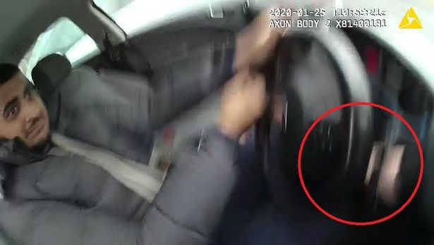 Shocking moment driver drags police officer 30ft while speeding away