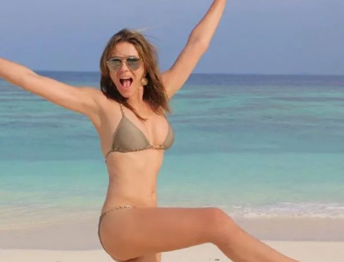 Picture: Elizabeth Hurley barely contains herself in sensational throwback photo